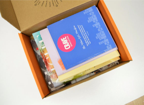Naked snacks snack box repurposed into book storage