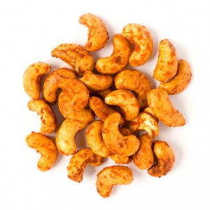 sriracha cashews snack mix made of roasted cashews, organic sriracha sauce, garlic powder and chili powder