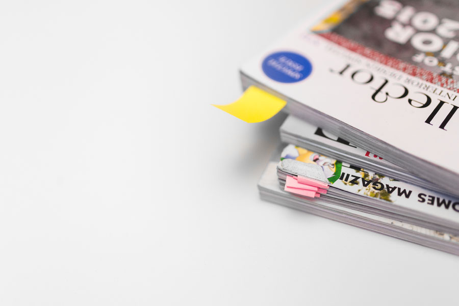 kaboompics.com_Stack of white magazines with copy space