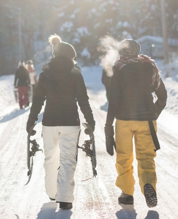two people walking together and snowshoeing