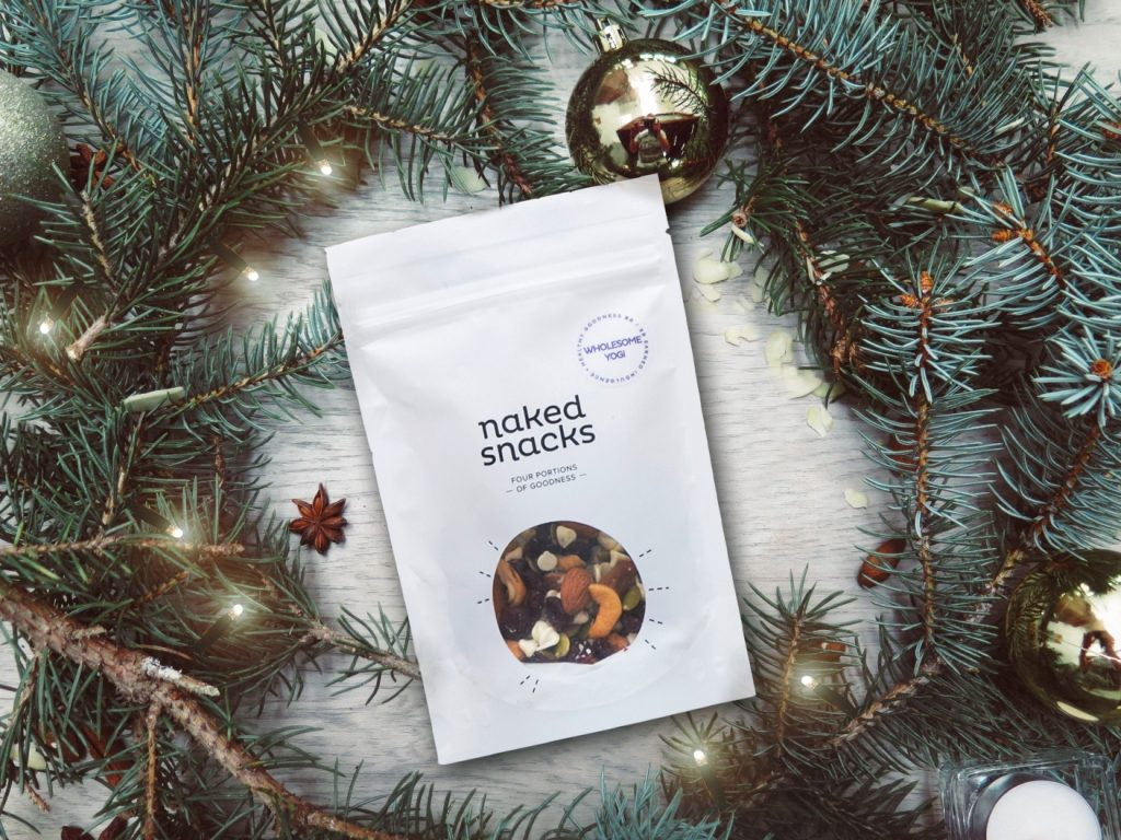 wholesome yogi snack bag from naked snacks surrounded by wreath and decorations