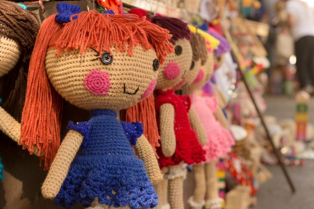 Row of knit dolls