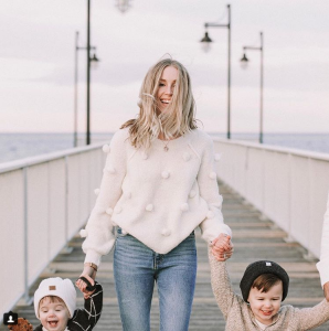 Shauna Dean, creator and Editor of the style blog Quentin & Co, holding her kids' hands