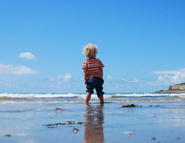 Kid standing on a beach