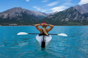 Girl kayaking on a lake