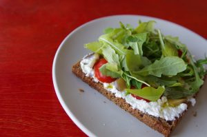 Snack with lettuce, spread and tomatos