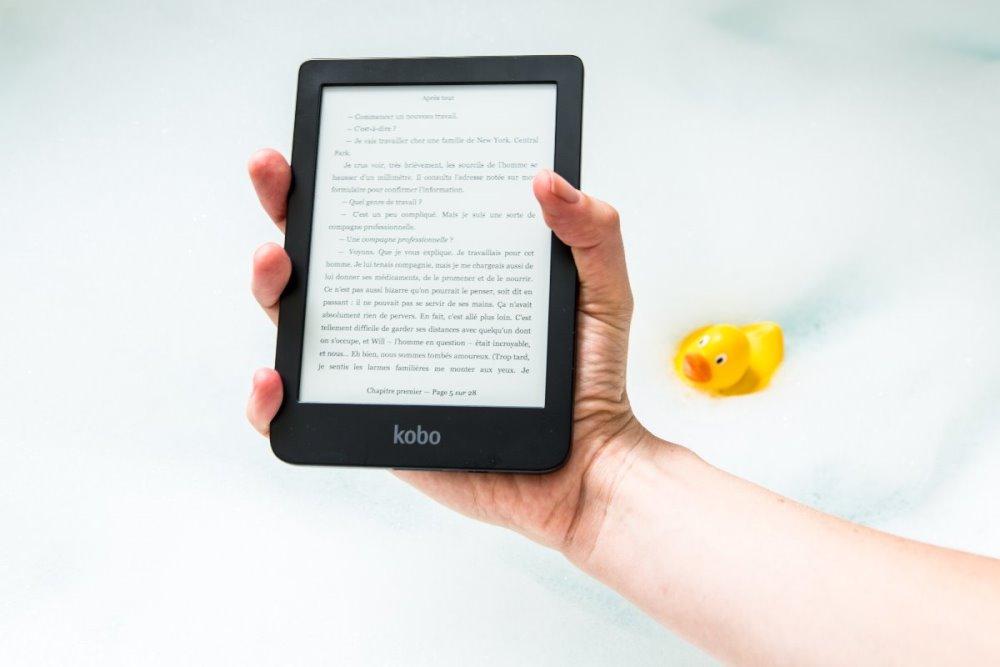 Hand holding up an e-reader