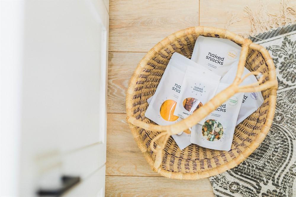 Wicker basket of bags of naked snacks