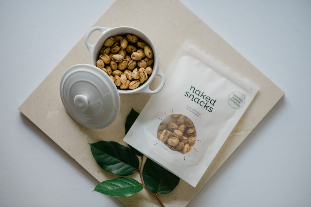 A bag of cracked pepper pistachios snacks from naked snacks