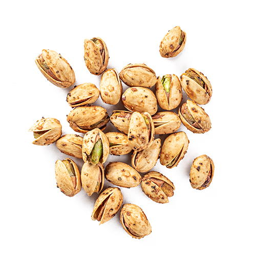 roasted pistachios coated in black pepper and lemon juice snack mix