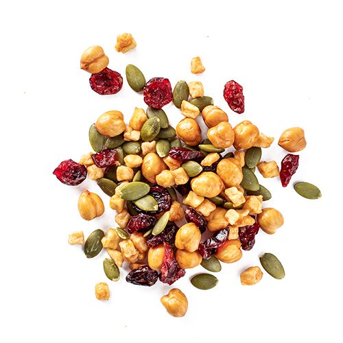 nutless wonder snack mix made of dried cranberries, salted chickpeas, apple pieces and pumpkin seeds