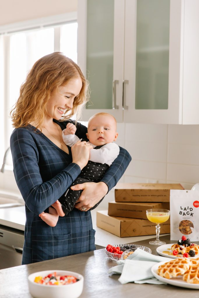 Ryley and baby Henry for Laid Back Snacks' Mother's Day 2021 Gift Box. Woman holding baby.